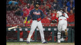 Atlanta Braves' Ozzie Albies reacts after striking out with bases loaded against Cincinnati Reds relief pitcher David Hernandez in the seventh inning of a baseball game, Thursday, April 25, 2019, in Cincinnati. (AP Photo/John Minchillo)