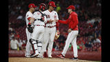 Cincinnati Reds starting pitcher Luis Castillo (58) is relieved by Cincinnati Reds manager David Bell, right, in the seventh inning of a baseball game, Thursday, April 25, 2019, in Cincinnati. (AP Photo/John Minchillo)