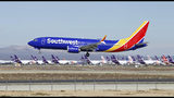 FILE - In this March 23, 2019, file photo, a Southwest Airlines Boeing 737 Max aircraft lands at the Southern California Logistics Airport in the high desert town of Victorville, Calif. Southwest Airlines Co. reports earns on Thursday, April 25. (AP Photo/Matt Hartman, File)
