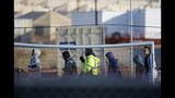 File - In this Dec. 13, 2018, file photo, teen migrants walk in line inside the Tornillo detention camp in Tornillo, Texas. A federal judge says he will give the Trump administration six months to identify children who were separated from their families at the U.S.-Mexico border early in the president's term. U.S. District Judge Dana Sabraw said Thursday, April 25, 2019, in San Diego that it was important to set a deadline for finding potentially thousands of children who were separated between July 1, 2017, and June 25, 2018. (AP Photo/Andres Leighton, File)