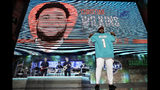 Clemson defensive tackle Christian Wilkins poses with his new jersey after the Miami Dolphins selected Wilkins in the first round at the NFL football draft, Thursday, April 25, 2019, in Nashville, Tenn. (AP Photo/Mark Humphrey)