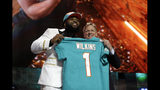 Clemson defensive tackle Christian Wilkins poses with NFL Commissioner Roger Goodell after the Miami Dolphins selected Wilkins in the first round at the NFL football draft, Thursday, April 25, 2019, in Nashville, Tenn. (AP Photo/Mark Humphrey)