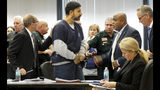 Nouman Raja is led away after he was sentenced to 25 years in prison Thursday, April 25, 2019. Raja, a former Palm Beach Gardens police officer, was convicted on one count each of manslaughter by culpable negligence and first-degree attempted murder. He shot and killed stranded motorist Corey Jones Oct. 18, 2015. (Lannis Waters/Palm Beach Post via AP, Pool)