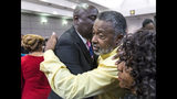 Clinton Jones, Sr., father of Corey Jones, right, is hugged by Jones family attorney Benjamin Crump after Nouman Raja was sentenced to 25 years in prison Thursday in West Palm Beach April 25, 2019. Raja, a former Palm Beach Gardens police officer, was convicted on one count each of manslaughter by culpable negligence and first-degree attempted murder. He shot and killed stranded motorist Corey Jones Oct. 18, 2015. (Lannis Waters/Palm Beach Post via AP, Pool)