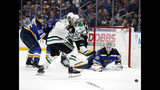 St. Louis Blues goaltender Jordan Binnington (50) loses his stick defending against pressure from Dallas Stars right wing Alexander Radulov (47) as the Blues' Colton Parayko (55) watches in the first period of Game 1 of an NHL second-round hockey playoff series Thursday, April 25, 2019, in St. Louis. (AP Photo/Jeff Roberson)