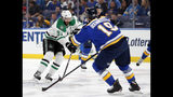 Dallas Stars center Tyler Seguin (91) makes a pass as St. Louis Blues' Jay Bouwmeester (19) defends during the first period in Game 1 of an NHL second-round hockey playoff series, Thursday, April 25, 2019, in St. Louis. (AP Photo/Jeff Roberson)