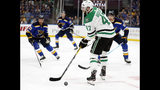 Dallas Stars right wing Alexander Radulov (47) handles the puck as St. Louis Blues' Ryan O'Reilly (90), Jay Bouwmeester (19) and Colton Parayko, right rear, defend during the first period in Game 1 of an NHL second-round hockey playoff series Thursday, April 25, 2019, in St. Louis. (AP Photo/Jeff Roberson)
