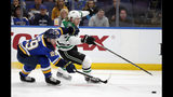 St. Louis Blues defenseman Vince Dunn (29) and Dallas Stars left wing Roope Hintz (24) chase after a loose puck during the first period in Game 1 of an NHL second-round hockey playoff series Thursday, April 25, 2019, in St. Louis. (AP Photo/Jeff Roberson)