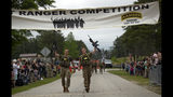 U.S. Army Capts. Michael Rose, left, and John Bergman, both of the 101th Airborne Division, cross the finish line to win the Best Ranger competition Sunday, April 14, 2019, at Fort Benning, Ga. (AP Photo/John Bazemore)