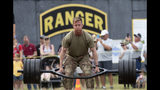 An Army Ranger lifts weights during the physical fitness portion of the Best Ranger competition Saturday, April 13, 2019, at Fort Benning, Ga. (AP Photo/John Bazemore)