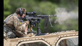 U.S. Army Sgt. Dylan Henry, of the 75th Ranger Regiment, fires a machine gun mounted on a vehicle during the Best Ranger competition Friday, April 12, 2019, in Fort Benning, Ga. (AP Photo/John Bazemore)