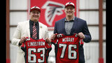 Atlanta Falcons NFL football first-round-draft picks Chris Lindstrom, left, of Boston College, and Kaleb McGary, from Washington, pose with their jerseys for a photo Friday, April 26, 2019, in Flowery Branch, Ga. Lindstrom and McGary are both offensive linemen. (AP Photo/John Bazemore)