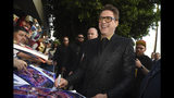 "Robert Downey Jr. signs autographs as he arrives at the premiere of ""Avengers: Endgame"" at the Los Angeles Convention Center on Monday, April 22, 2019. (Photo by Chris Pizzello/Invision/AP)"