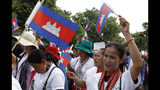 Cambodian workers march as they a gather to mark May Day near Wat Phnom, center of Phnom Penh, Cambodia, Wednesday, May 1, 2019. Some hundreds of workers staged a rally, demanding a better working condition. (AP Photo/Heng Sinith)