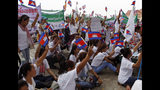 Cambodian workers stage a rally marking May Day at Tonle Sap river bank, in Phnom Penh, Cambodia, Wednesday, May 1, 2019. Some hundreds of workers staged a rally, demanding a better working condition. (AP Photo/Heng Sinith)