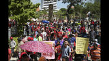 Malaysian workers stage a rally marking May Day in Kuala Lumpur, Malaysia, Wednesday, May 1, 2019. Hundreds of workers demand raise of basic salary and ending towards discrimination. (AP Photo/Annice Lyn)
