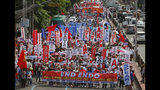 """Thousands of workers march towards the Presidential Palace in Manila to pay tribute to workers in celebration of International Labor Day Wednesday, May 1, 2019 in the Philippines. The workers scored President Rodrigo Duterte allegedly for reneging in his campaign promise three years ago to end temporary hiring known as """"contractualization"""" or """"ENDO (End of Contract)"""". (AP Photo/Bullit Marquez)"""