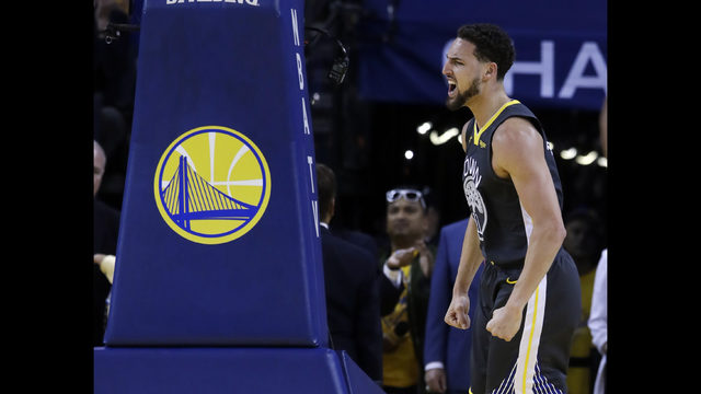 457f3e47f9eb Golden State Warriors  Klay Thompson reacts after scoring against the  Houston Rockets during the first half of Game 2 of a second-round NBA  basketball ...