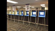 FILE - In this Sept. 20, 2018, file photo, voting booths stand ready in downtown Minneapolis. Whether campaigns have learned from the cyberattacks in the 2016 election is a critical question ahead of next year's presidential race. . (AP Photo/Steve Karnowski, File)