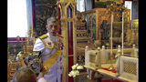 In this photo released by the Public Relation Department, Thailand's King Maha Vajiralongkorn lights a candle during a ceremony to pay homage to Vajiralongkorn's royal ancestors, at Paisarn Taksin Throne Hall in Bangkok, Thailand, Friday, May 3, 2019. The coronation ceremony for 66-year-old King Maha Vajiralongkorn, also known as King Rama X, will be held on May 4-6, 2019. (Public Relation Department via AP)