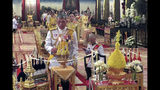 In this photo released by the Public Relation Department, Thailand's King Maha Vajiralongkorn, foreground, lights a candle with Queen Suthida , centre backgrond, during a ceremony to pay homage to Vajiralongkorn's royal ancestors, at Paisarn Taksin Throne Hall in Bangkok, Thailand, Friday, May 3, 2019. The coronation ceremony for 66-year-old King Maha Vajiralongkorn, also known as King Rama X, will be held on May 4-6, 2019. (Public Relation Department via AP)
