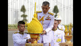 Thailand's King Maha Vajiralongkorn, center, pays homage to the Equestrian Statue of King Chulalongkorn in Bangkok, Thursday, May 2, 2019. The coronation ceremonies for 66-year-old King Maha Vajiralongkorn, also known as King Rama X, will be held on May 4-6, 2019. (Pool Photo via AP)