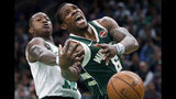 Milwaukee Bucks' Eric Bledsoe (6) loses control of the ball against Boston Celtics' Terry Rozier, left, during the first half of Game 4 of a second-round NBA basketball playoff series in Boston, Monday, May 6, 2019. (AP Photo/Michael Dwyer)