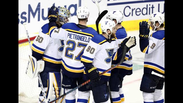 5d3ff71b172 St. Louis Blues goaltender Jordan Binnington (50) celebrates with Alex  Pietrangelo (27)
