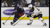 Columbus Blue Jackets' Boone Jenner, left, looks for an open shot as Boston Bruins' Torey Krug defends during the second period of Game 6 of an NHL hockey second-round playoff series Monday, May 6, 2019, in Columbus, Ohio. (AP Photo/Jay LaPrete)