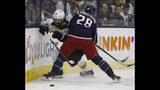 Columbus Blue Jackets' Oliver Bjorkstrand, right, of Denmark, checks Boston Bruins' Marcus Johansson, of Sweden, during the first period of Game 6 of an NHL hockey second-round playoff series Monday, May 6, 2019, in Columbus, Ohio. (AP Photo/Jay LaPrete)