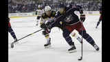 Columbus Blue Jackets' Josh Anderson, right, carries the puck upice in front of Boston Bruins' Brandon Carlo during the second period of Game 6 of an NHL hockey second-round playoff series Monday, May 6, 2019, in Columbus, Ohio. (AP Photo/Jay LaPrete)