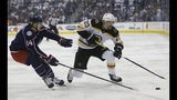 Boston Bruins' Joakim Nordstrom, right, of Sweden, carries the puck upice as Columbus Blue Jackets' Dean Kukan, of Switzerland, defends during the first period of Game 6 of an NHL hockey second-round playoff series Monday, May 6, 2019, in Columbus, Ohio. (AP Photo/Jay LaPrete)