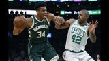 Boston Celtics' Al Horford (42) defends against Milwaukee Bucks' Giannis Antetokounmpo (34) during the first half of Game 4 of a second-round NBA basketball playoff series in Boston, Monday, May 6, 2019. (AP Photo/Michael Dwyer)