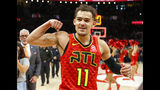FILE - In this March 31, 2019, file photo, Atlanta Hawks guard Trae Young (11) reacts after the Hawks won in overtime of an NBA basketball game against the Milwaukee Bucks,in Atlanta. Hawks general manager Travis Schlenk has plenty to be excited about as his team's first NBA draft pick is slotted at No. 5 entering next week's draft lottery. The Hawks had big production from last year's first pick, point guard Trae Young, and will be looking for another impact player to boost the team's rebuilding effort. (AP Photo/Todd Kirkland, File)