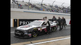 The team of Kevin Harvick pushes their race car down pit road after a NASCAR Cup series auto race was postponed due to inclement weather at Dover International Speedway in Dover, Del., Sunday, May 5, 2019. The race was rescheduled for Monday (AP Photo/Jason Minto)