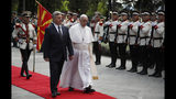 Pope Francis is welcomed by North Macedonia President Gjorge Ivanov after landing at the airport of Skopje, North Macedonia, Tuesday, May 7, 2019. Francis, who is on a three-day trip to the Balkans, is visiting North Macedonia for the first-ever papal visit to the country. (AP Photo/Thanassis Stavrakis)