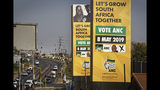 Electoral campaign signs for the ruling African National Congress (ANC) stand next to a road junction in Soweto, Johannesburg, South Africa, Tuesday, May 7, 2019. The upcoming elections on Wednesday will take place 25 years after the end of apartheid and are the country's sixth all-race polls. (AP Photo/Ben Curtis)