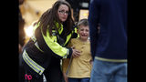 RETRANSMIT WITH ALTERNATE CROP Officials guide students off a bus and into a recreation center where they were reunited with their parents after a shooting at a suburban Denver middle school Tuesday, May 7, 2019, in Highlands Ranch, Colo. (AP Photo/David Zalubowski)