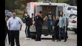 Students exit an ambulance at a recreation center for students to get reunited with their parents after a shooting at a suburban Denver middle school Tuesday, May 7, 2019, in Highlands Ranch, Colo. (AP Photo/David Zalubowski)