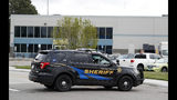 Douglas County, Colo., Sheriffs Department vehicles block the road to the STEM School Highlands Ranch after a shooting at the public charter school Tuesday, May 7, 2019, in Highlands Ranch, Colo. (AP Photo/David Zalubowski)