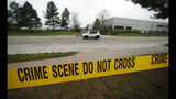 Police tape remains near the scene following Tuesday's shooting at STEM Highlands Ranch school, Wednesday, May 8, 2019, in Highlands Ranch, Colo. (AP Photo/David Zalubowski)