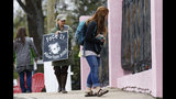 FILE - In this March 20, 2018, file photo, anti-abortion sidewalk counselors call out to a woman entering the Jackson Women's Health Organization's clinic, the only facility in the state that performs abortions, in Jackson, Miss. A new Mississippi law could make it nearly impossible for most pregnant women to get an abortion there if it survives a court challenge. (AP Photo/Rogelio V. Solis, File)