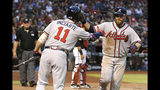 Atlanta Braves' Brian McCann, right, celebrates with Ender Inciarte (11) after hitting a solo home run against the Arizona Diamondbacks in the seventh inning during a baseball game, Saturday, May 11, 2019, in Phoenix. (AP Photo/Rick Scuteri)