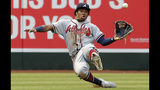 Atlanta Braves left fielder Ronald Acuna Jr. makes a sliding catch for an out on a ball hit by Arizona Diamondbacks' Ketel Marte in the fifth inning during a baseball game, Saturday, May 11, 2019, in Phoenix. (AP Photo/Rick Scuteri)