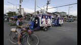In this Thursday, May 9, 2019 photo, pedicabs with election posters go around Manila's slum district of Tondo, Philippines. Philippine President Rodrigo Duterte's name is not on the ballot but Monday's mid-term elections are seen as a referendum on his phenomenal rise to power, marked by his gory anti-drug crackdown and his embrace of China. (AP Photo/Aaron Favila)