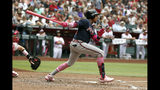Atlanta Braves Johan Camargo hits an RBI single against the Arizona Diamondbacks in the third inning during a baseball game, Sunday, May 12, 2019, in Phoenix. (AP Photo/Rick Scuteri)