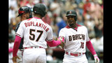Arizona Diamondbacks' Adam Jones (10) celebrates with Jon Duplantier after hitting a two run homerun against the Atlanta Braves in the fourth inning during a baseball game, Sunday, May 12, 2019, in Phoenix. (AP Photo/Rick Scuteri)