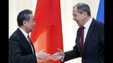 Russian Foreign Minister Sergey Lavrov, right, shakes hands with Chinese Foreign Minister Wang Yi after their joint news conference following the talks in Sochi, Russia, Monday, May 13, 2019. (AP Photo/Pavel Golovkin, Pool)