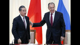Russian Foreign Minister Sergey Lavrov, right, and Chinese Foreign Minister Wang Yi leave their joint news conference following the talks in Sochi, Russia, Monday, May 13, 2019. (AP Photo/Pavel Golovkin, Pool)