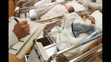 FILE - This Feb. 16, 2017 file photo shows newborn babies in the nursery of a postpartum recovery center in upstate New York. According to a government report released Wednesday, May 15, 2019, U.S. birth rates reached record lows for women in their teens and 20s, leading to the fewest babies in 32 years. (AP Photo/Seth Wenig, File)
